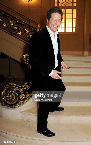 Hugh Grant attends a drinks reception celebrating Patrick Cox's 50th Birthday party at Cafe Royal on March 15 2013 in London England