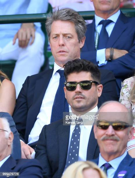 Hugh Grant attends the men's singles final on day thirteen of the Wimbledon Tennis Championships at the All England Lawn Tennis and Croquet Club on...