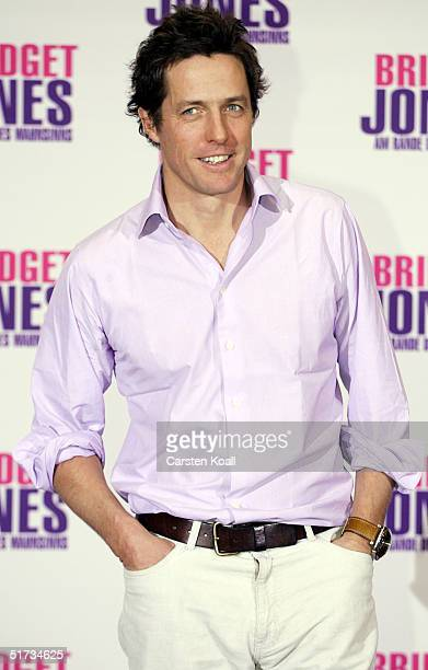Hugh Grant pose at the photocall to promote Bridget Jones The Edge of Reason at Hotel Adlon on November 11 2004 in Berlin Germany
