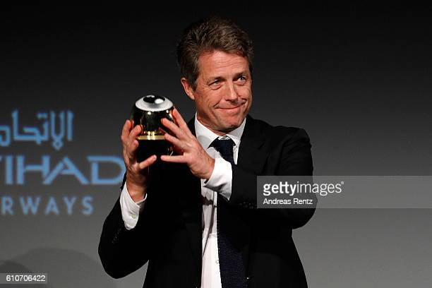 Hugh Grant presents his award at the 'Florence Foster Jenkins' Premiere and Golden Icon award ceremony during the 12th Zurich Film Festival on...