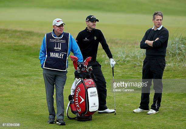 Hugh Grant the British film actor on the 17th hole with his standin playing partner Stuart Manley of Wales during the second round of the Alfred...