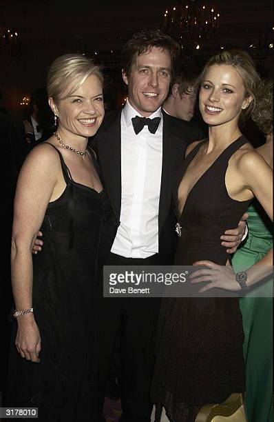 Hugh Grant with Mariella Frostrup and Laura Bailey attend the Standard Film Awards for 2003 at the Savoy Hotel on March 1 2003 in London