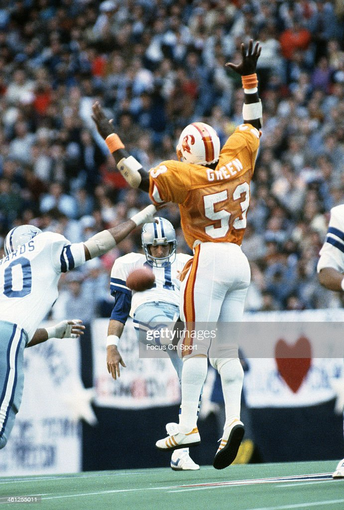 Hugh Green of the Tampa Bay Buccaneers rushes punter Danny White of the Dallas Cowboys during the NFL/NFC Divisional Playoff game January 2 1982 at...