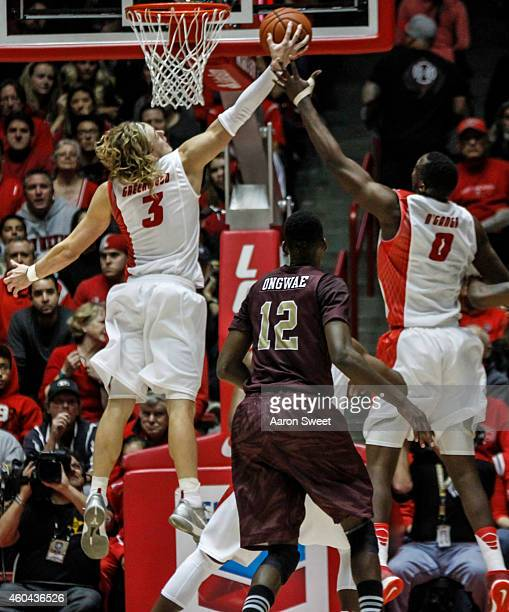 Hugh Greenwood and teammate JJ N'Ganga of the New Mexico Lobos jump for a rebound as Tylor Ongwae of the LouisianaMonroe Warhawks defends during...