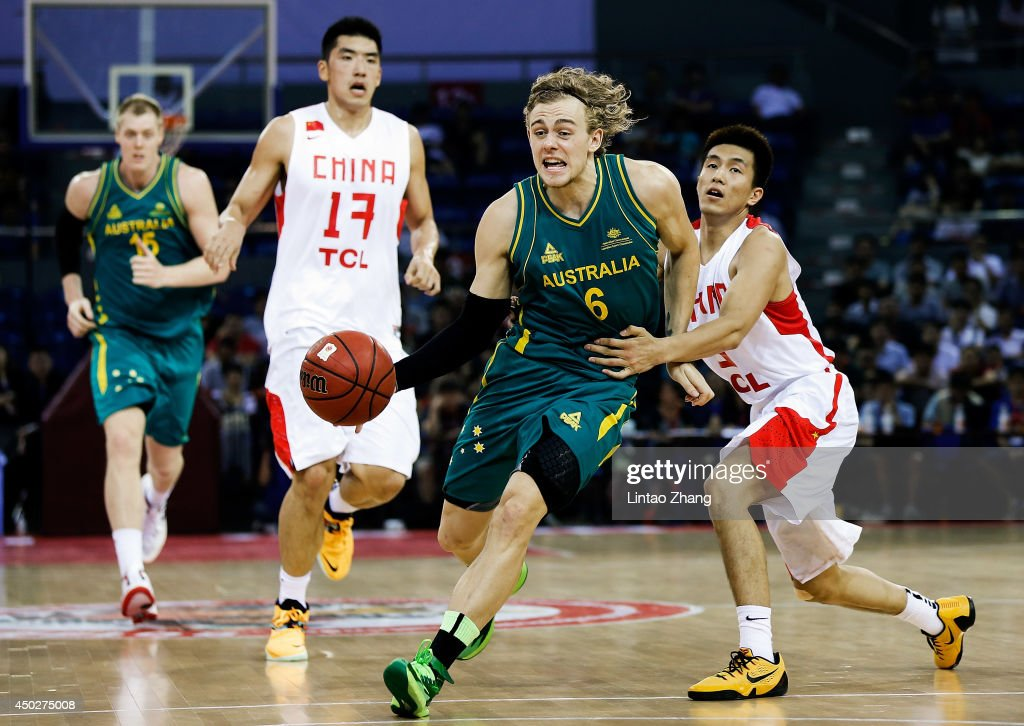 Hugh Greenwood (L) of Australia drives against Liu Xiaoyu of China during the 2014 Sino-Australia Men's International Basketball Challenge match between the Australian Boomers and China at Liyang City Stadium on June 8, 2014 in Changzhou, China.