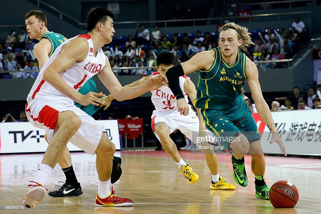 Hugh Greenwood (C) of Australia looks to pass against Guo Ailun of China during the 2014 Sino-Australia Men's International Basketball Challenge match between the Australian Boomers and China at Liyang City Stadium on June 8, 2014 in Changzhou, China.