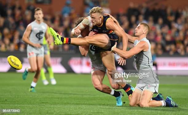 Hugh Greenwood of the Adelaide Crows breaks away from Liam Jones of the Blues during the round seven AFL match between the Adelaide Crows and the...