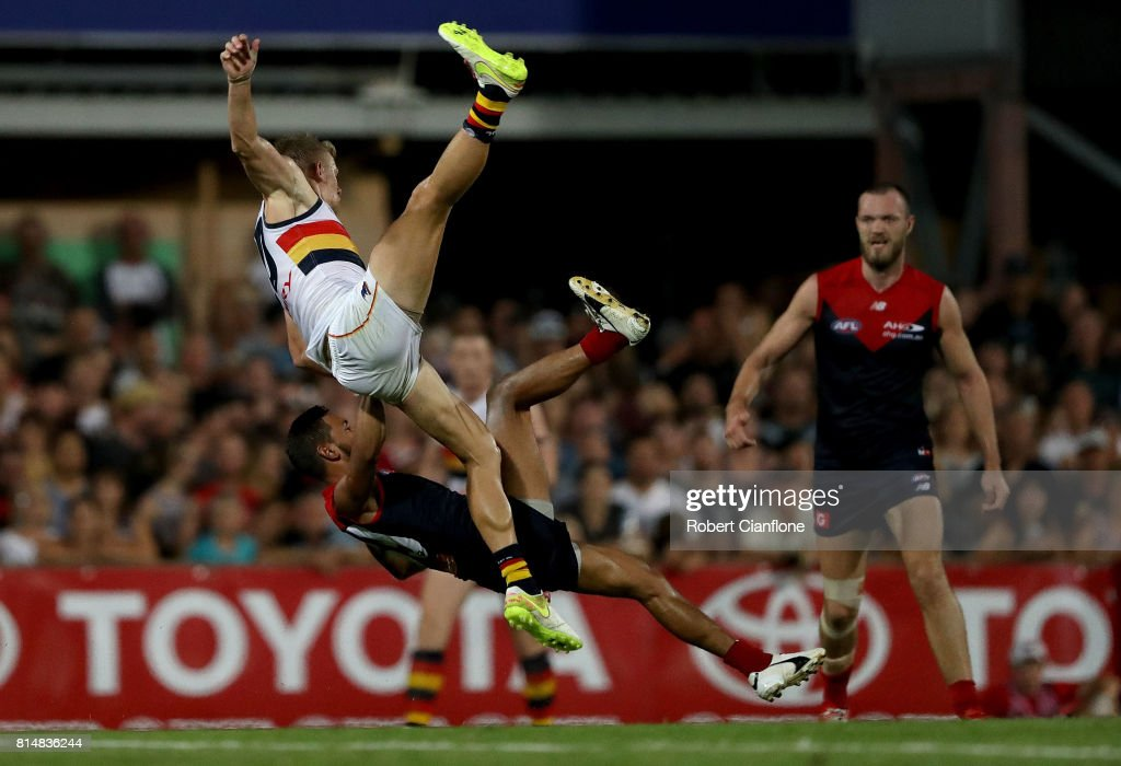 Hugh Greenwood of the Crows and Neville Jetta of the Demons collide during the round 17 AFL match between the Melbourne Demons and the Adelaide Crows at TIO Stadium on July 15, 2017 in Darwin, Australia.