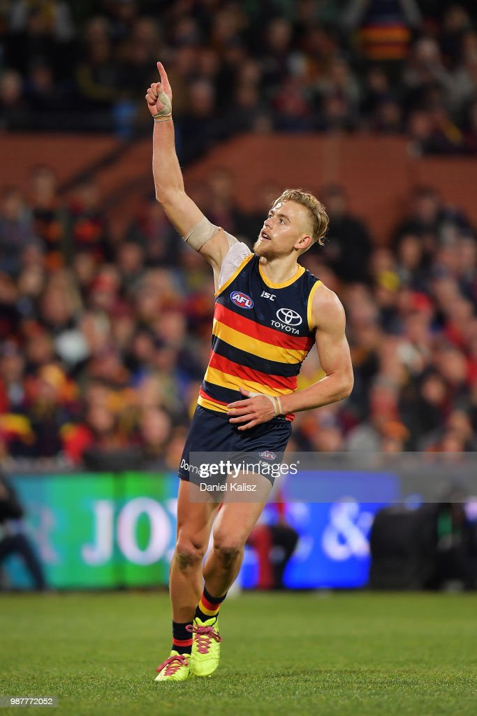 Hugh Greenwood of the Crows celebrates after kicking a goal during the round 15 AFL match between the Adelaide Crows and the West Coast Eagles at Adelaide Oval on June 30, 2018 in Adelaide, Australia.
