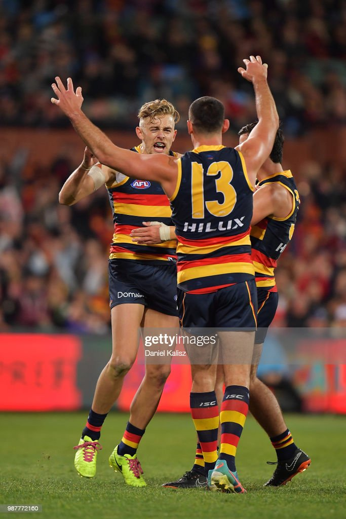 Hugh Greenwood of the Crows celebrates with Taylor Walker of the Crows after kicking a goal during the round 15 AFL match between the Adelaide Crows and the West Coast Eagles at Adelaide Oval on June 30, 2018 in Adelaide, Australia.