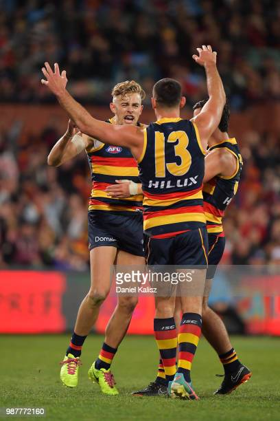 Hugh Greenwood of the Crows celebrates with Taylor Walker of the Crows after kicking a goal during the round 15 AFL match between the Adelaide Crows...