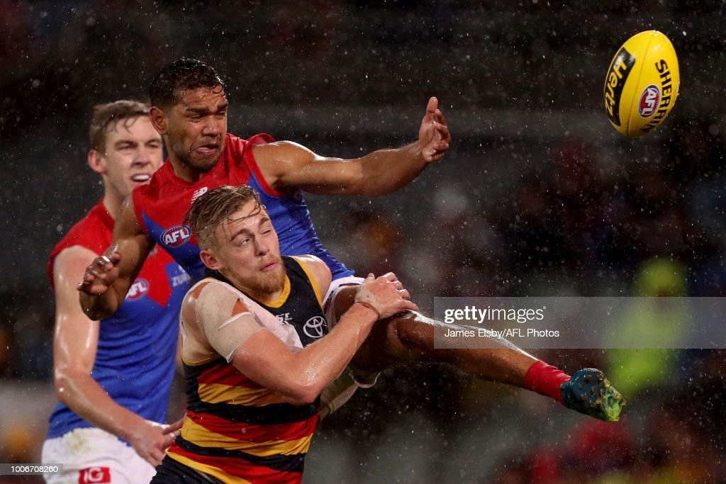 Hugh Greenwood of the Crows clashes with Neville Jetta of the Demons clashes with during the 2018 AFL round 19 match between the Adelaide Crows and the Melbourne Demons at Adelaide Oval on July 28, 2018 in Adelaide, Australia.