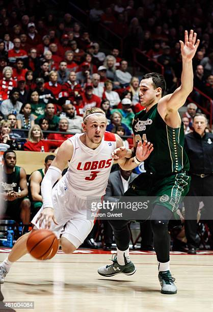 Hugh Greenwood of the New Mexico Lobos drives to the basket against JJ Avila of the Colorado State Rams during their game at The WisePies Arena on...