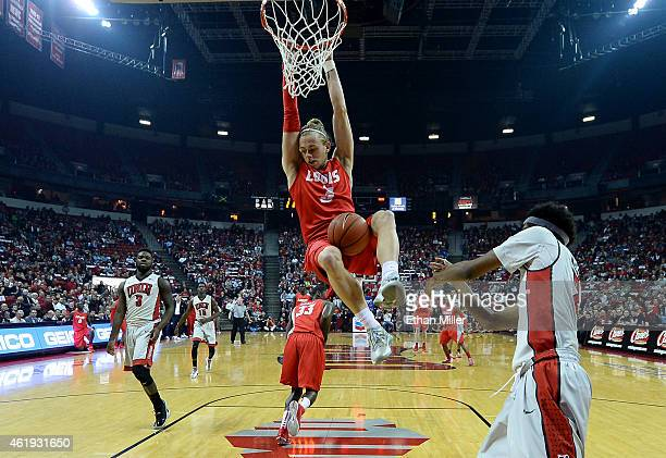 Hugh Greenwood of the New Mexico Lobos dunks against the UNLV Rebels during their game at the Thomas Mack Center on January 21 2015 in Las Vegas...