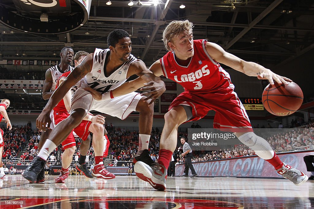 Hugh Greenwood #3 of the New Mexico Lobos handles the ball against JaQuon Parker #44 of the Cincinnati Bearcats during the game at Fifth Third Arena on December 27, 2012 in Cincinnati, Ohio.