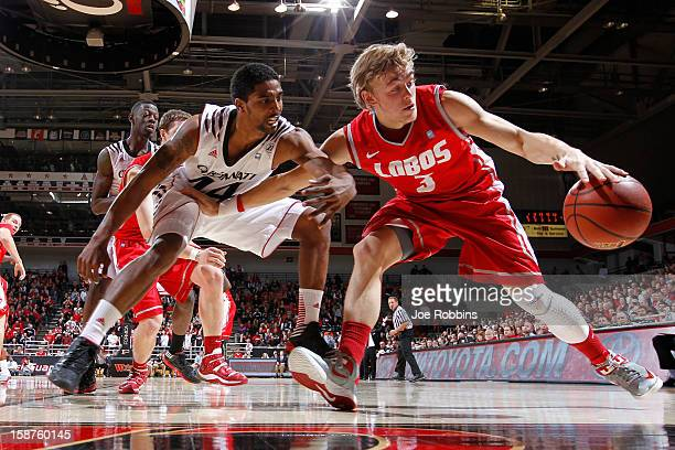 Hugh Greenwood of the New Mexico Lobos handles the ball against JaQuon Parker of the Cincinnati Bearcats during the game at Fifth Third Arena on...
