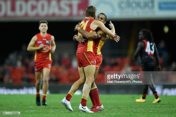 Hugh Greenwood of the Suns celebrates kicking a goal during the round 11 AFL match between the Gold Coast Suns and the Essendon Bombers at Metricon...