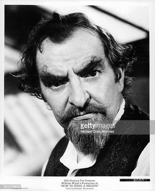 Hugh Griffith head of a distinguished and wealthy family is disappointed in his daughter's misunderstanding of his success as a forger in a scene...