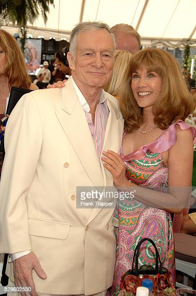 Hugh Hefner and actress Barbi Benton posing at the Playboy Playmate of the Year 2007 luncheon held at the Playboy Mansion in Los Angeles California