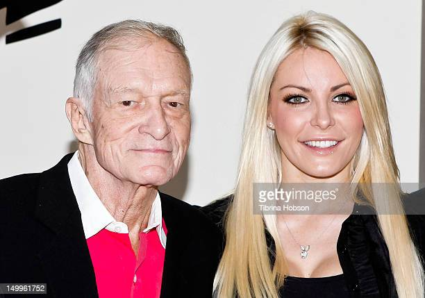 Hugh Hefner and Crystal Harris attend the Beverly Hills City Council and Playboy Enterprises ribboncutting ceremony for Beverly Hills Playboy World...