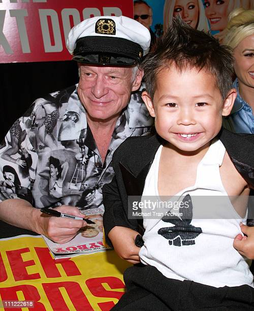 Hugh Hefner and fan Jordan during The Girls Next Door InStore DVD and Magazine Autograph Signing at Tower Records on Sunset in West Hollywood...
