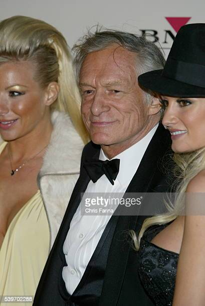 Hugh Hefner and his girlfriends arrive at the BMG Grammy After Party at Avalon