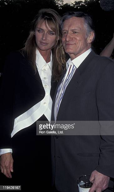 Hugh Hefner and Kimberley Conrad attend Playboy Magazine Party on April 6 1995 at the Playboy Mansion in Beverly Hills California