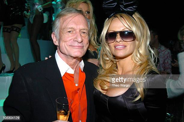 Hugh Hefner and Pamela Anderson during Playboy's 50th Anniversary Celebration in New York City Inside at New York Armory in New York City New York...