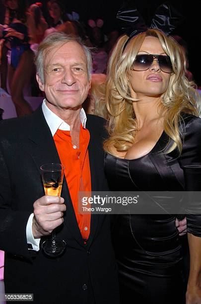 Hugh Hefner and Pamela Anderson during Playboy's 50th Anniversary Celebration in New York City Inside at New York Armory in New York City New York...