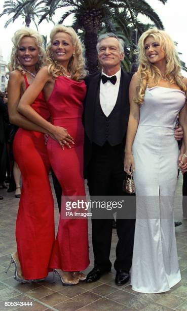 Hugh Hefner and Playboy models arrive at the Palais des Festivals for premiere of the film Entrapment during the 52nd Cannes Film Festival in France...