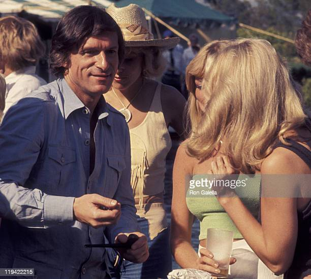 Hugh Hefner and Sondra Theodore attend Playboy Tenns and Crumpet Party on May 21 1977 at the Playboy Mansion in Beverly Hills California