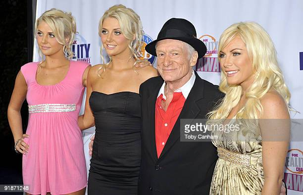 Hugh Hefner and The new girls next door pose for a picture at the 2009 Fox Reality Channels Really Awards held at The Music Box @ Fonda on October 13...