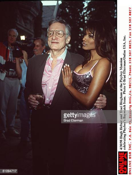 Hugh Hefner And Traci Bingham At The Playboy Mansion Celebrating Playboy's Baywatch Issue.