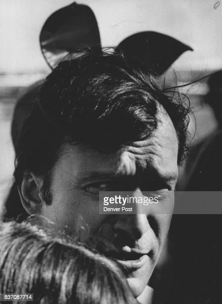 Hugh Hefner appears to be wearing 'Trademark' But the ears belong to a Playboy Club bunny behind him Credit The Denver Post