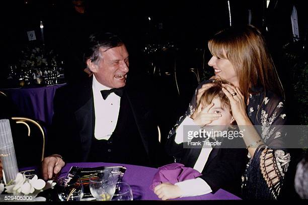 Hugh Hefner at a formal party with his son Marston and wife Kimberley