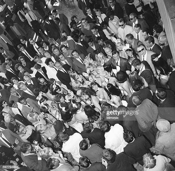 Hugh Hefner Boss of the Playboy Empire arrives with an entourage of Bunny Girls at London Heathrow Airport, Saturday 25th June 1966. Heff, is in...