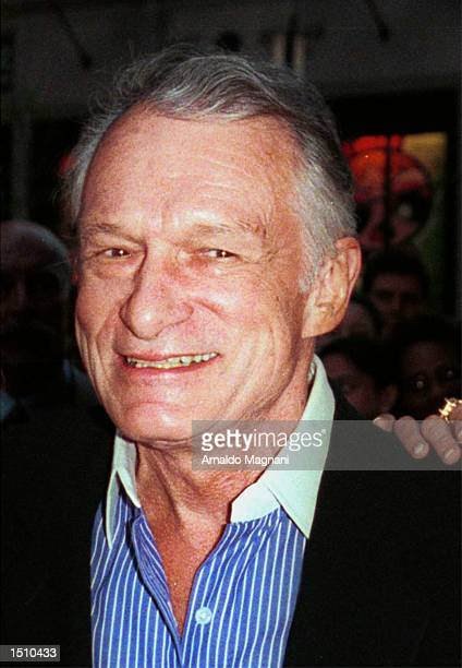 Hugh Hefner celebrates the upcoming May issue of Playboy featuring twins Mandy and Sandy Bentley April 12 2000 in New York City