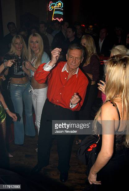 Hugh Hefner dances with Playboy playmates during Super Bowl XXXVII Hugh Hefner and Playboy Host Playboy's Fourth Annual Super Saturday Night Party at...