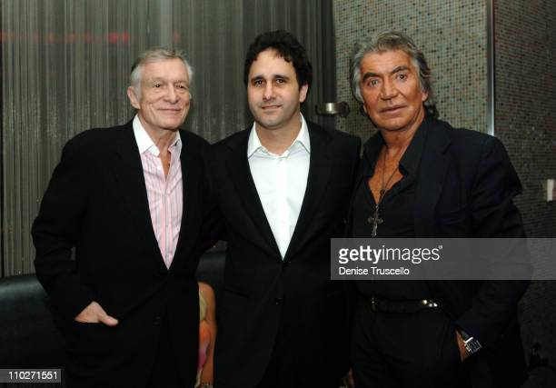 Hugh Hefner George Maloof and Roberto Cavalli during The Premiere of the New Playboy Bunny Uniform Hosted by Hugh Hefner and Roberto Cavalli at The...