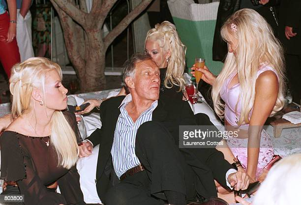 Hugh Hefner hangs out with his Playboy playmates at the Sky Bar for Playboy Playmate of the Year 2001 party for model Brande Roderick April 26 2001...