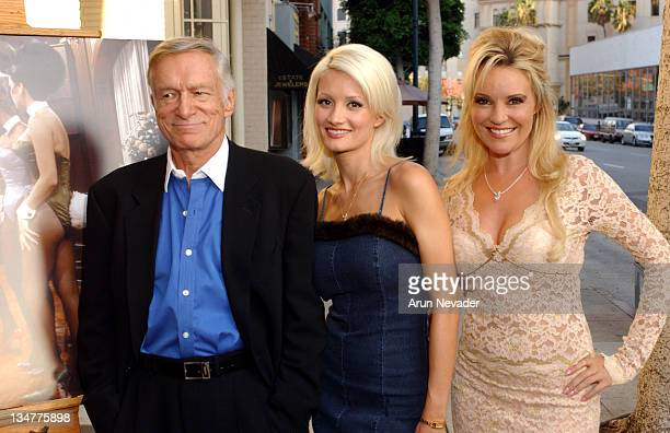 Hugh Hefner Holly and Bridget during Christie's Exhibits Playboy at 50 Selections from the Archives at Christie's in Beverly Hills California United...
