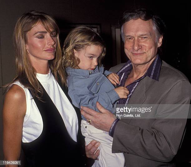 Hugh Hefner Kimberley Conrad and son Marston Hefner attend Playboy Mansion Open House Party on August 27 1992 at the Playboy Mansion in Beverly Hills...