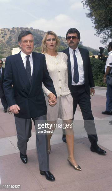 Hugh Hefner Kimberly Conrad and Guest during Funeral for Sammy Davis Jr May 18 1990 at Forest Lawn Memorial Park in Los Angeles California United...