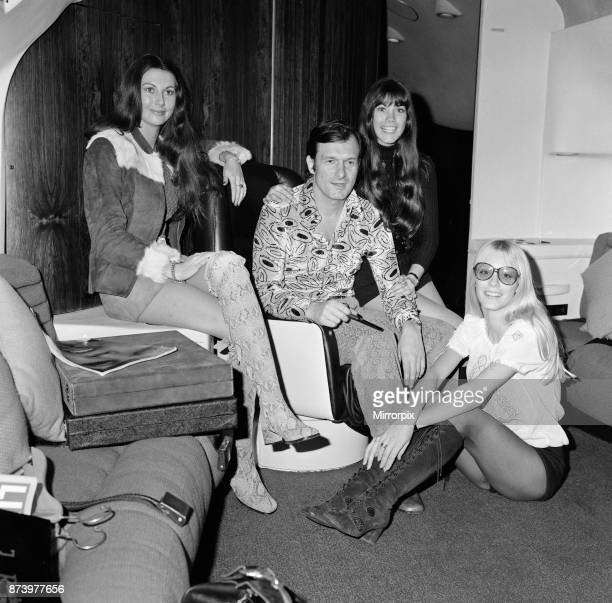 Hugh Hefner pictured in the Playboy Jet with left to right Marilyn Cole Hefner's girlfriend Barbi Benton and seated Connie Kreski The gleaming black...