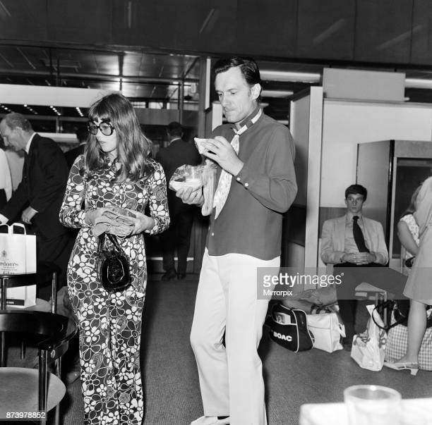 Hugh Hefner pictured with his girlfriend Barbi Benton at the airport 6th September 1969