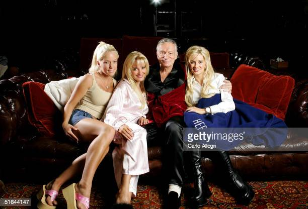 Hugh Hefner poses with Kendra Wilkinson Bridget Marquardt and Holly Madison before a screening of Bonnie and Clyde at the Playboy Mansion June 18...