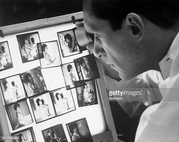 Hugh Hefner who launched one of the most controversial magazines in publishing history views photographs in his Chicago office