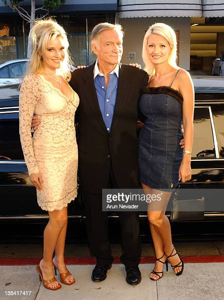 Hugh Hefner with Bridget and Holly during Christie's Exhibits Playboy at 50 Selections from the Archives at Christie's in Beverly Hills California...