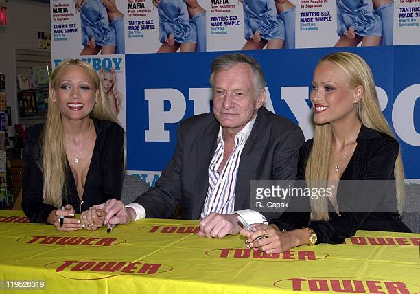Hugh Hefner with cover girls Sandy Bentley and Mandy Bentley