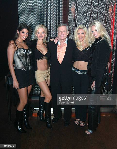 Hugh Hefner with playmates during Miss November 2003 Divini Rae Celebrates the 50th Anniversary of Playboy Magazine at Ivar in Hollywood, United...